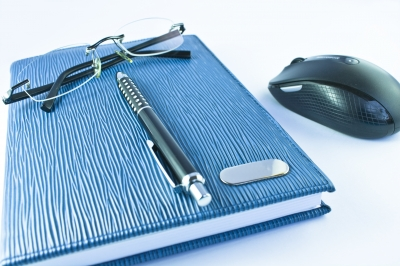 ID-10092854 - Glass And Pen On Notebook Stock Photo - sritangphoto