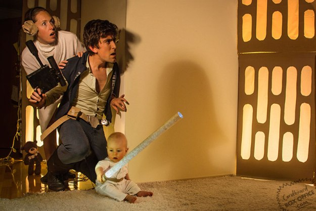 Caption: Parents Lilly and Leon recreating a scene from Star Wars with their son Orson. (Source)
